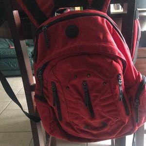 Oakley red backpack